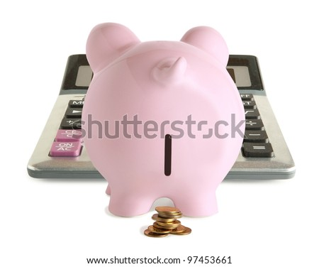 Pink piggy bank and calculator isolated on white background - stock photo