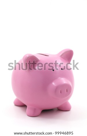 Pink piggy bank isolated on white. - stock photo