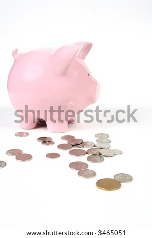 Pink Piggy Bank on isoalted on white background with coins - stock photo