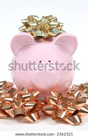 Pink Piggy Bank on isolated on white background with Christmas bows - stock photo