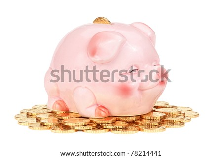 Pink piggy bank on pile of coins, isolated on the white background, clipping path included. - stock photo