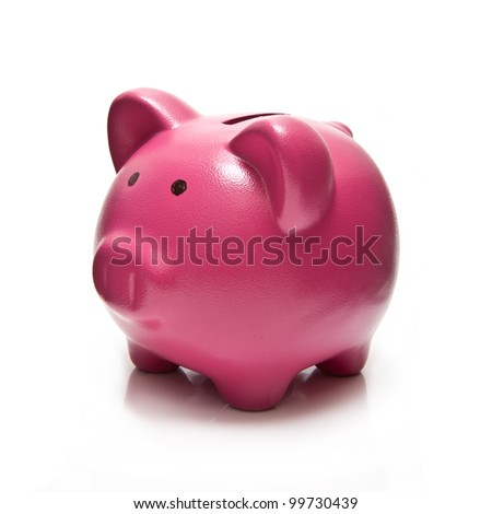 Pink piggy bank or money box isolated on a white studio background. - stock photo