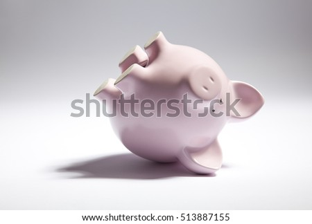 Pink piggy bank upside down.