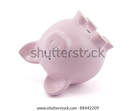 Pink piggy bank upside down. Clipping path included. - stock photo