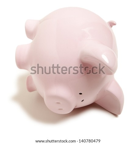 Pink piggy bank upside down isolated on white background - stock photo