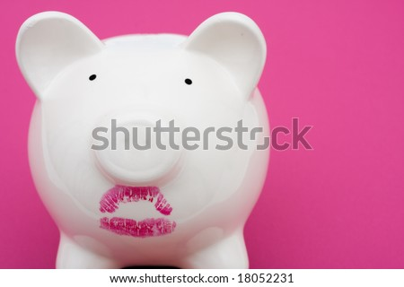 Pink piggy bank wearing red lipstick on pink background, pig wearing lipstick is still a pig