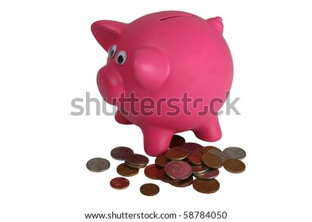 Pink piggy bank with a pile of money coins - isolated - stock photo