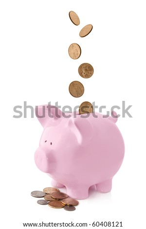 Pink piggy bank, with coins falling into slot.  Isolated on white.