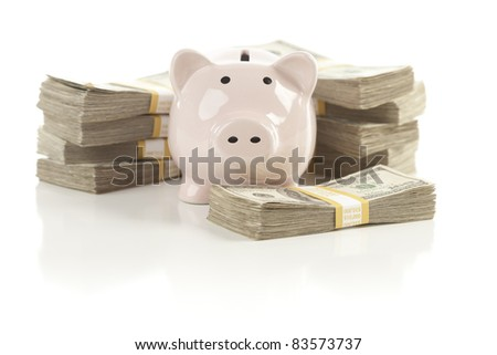 Pink Piggy Bank with Stacks of Hundreds of Dollars Isolated on a White Background. - stock photo