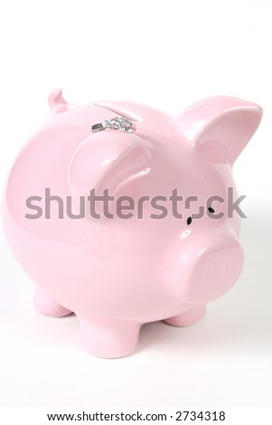 Pink Piggy Bank with Wedding Ring, isolated on white background