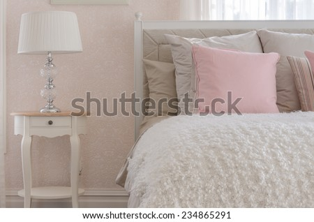 pink pillow on white luxury bed in bedroom at home - stock photo