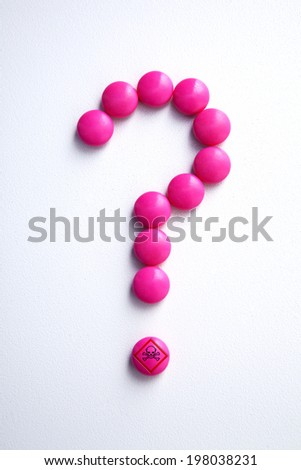 Pink Pills in the shape of a question mark - stock photo