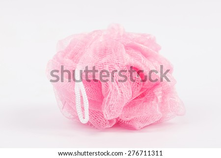 Pink  plastic bath puff isolated on white - stock photo