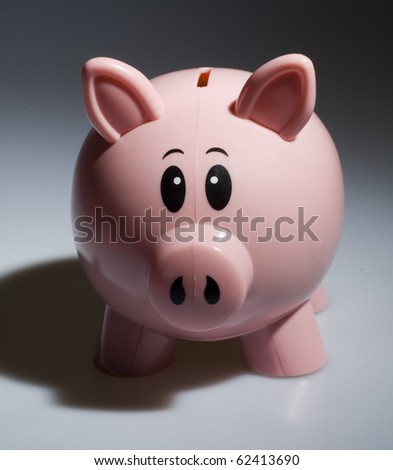 Pink Plastic Piggy Bank with Shadows, Great for Use in these Economic Times. - stock photo