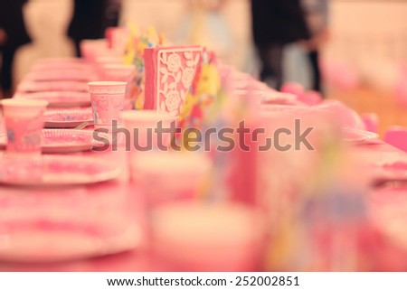 Pink plates for a birthday party - stock photo