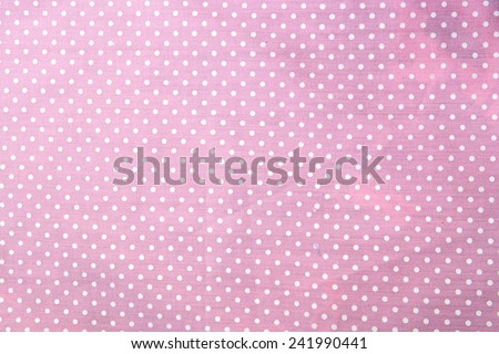 pink polka dot fabric closeup. May use as background - stock photo