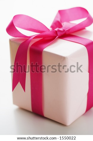 Pink present with pink bow - stock photo