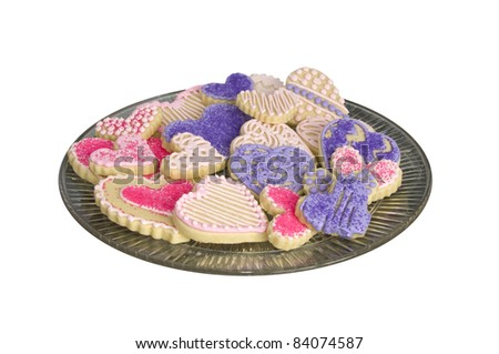 Pink purple and white heart shaped sugar cookies isolated on white