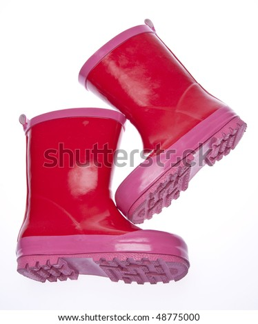 Pink rain boots isolated on white with a clipping path.