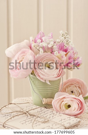 Pink ranunculus flowers and letters - stock photo