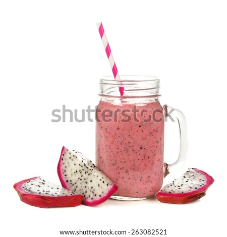 Pink raspberry, dragon fruit smoothie in jar mug with fruit slices isolated on white - stock photo