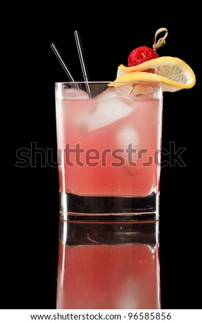 pink raspberry lemonade isolated on a black background garnished with lemon and red raspberry - stock photo
