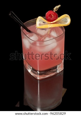 pink raspberry lemonade isolated on a black background garnished with lemon and red raspberry view from the top - stock photo