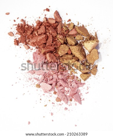 pink, red and golden eyeshadow isolated on white background