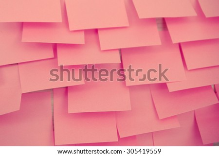 pink reminder note background texture process with vintage style - stock photo