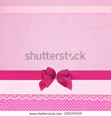 Pink retro polka dot textile background with ribbons and bow - stock photo