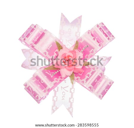 Pink ribbon bow with flower isolated on white background