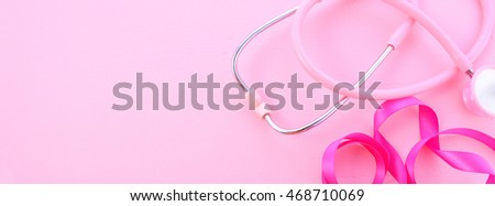 Pink Ribbon Charity background with ribbons and pink stethoscope on a pink wood table, sized to fit a popular social media cover image placeholder.