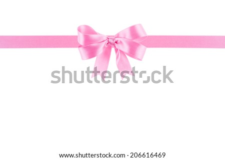 Pink ribbon with a bow on white background