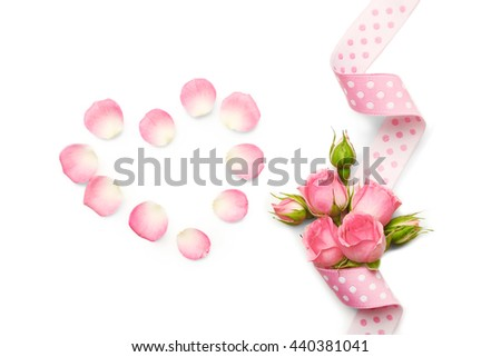 Pink ribbon with flowers. Wedding concept - stock photo