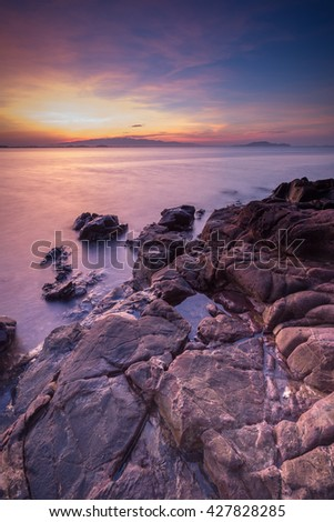 pink rock at coastline of Kham Nhu Bay in Chanthaburi province in east of Thailand - stock photo