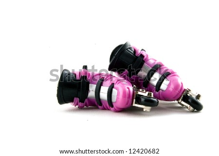 pink rollerblades laying down isolated on a white background - stock photo