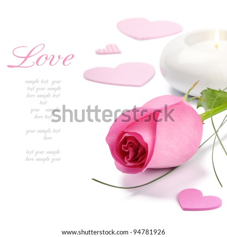 Pink rose and candle over white
