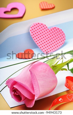 Pink rose and envelope in romantic set - stock photo