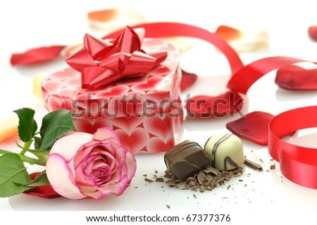 pink rose and gift for St.Valentine's Day - stock photo