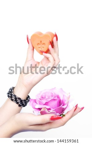 Pink rose and soap with hands - stock photo