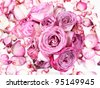 Pink rose bouquet on rose petals background - stock photo