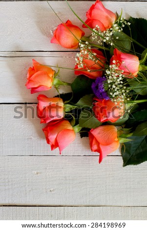 Pink rose flowers on white wooden background