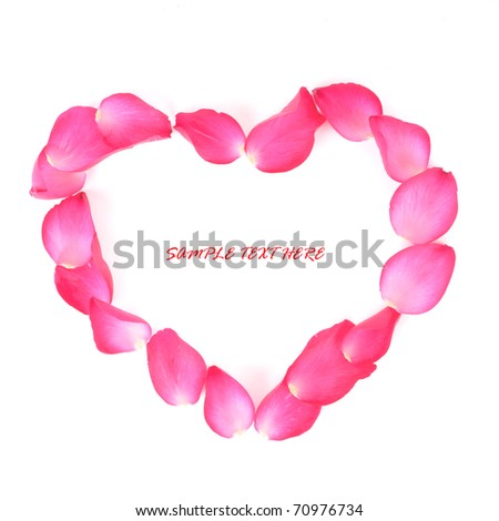 "pink rose petals are shaped as ""heart"" on white background with a copy space - stock photo"