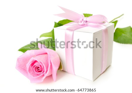 Pink rose with gift box on white background - stock photo