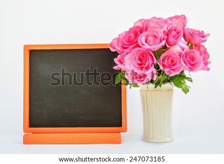 Pink roses and blackboard on white background, Valentines Day. - stock photo