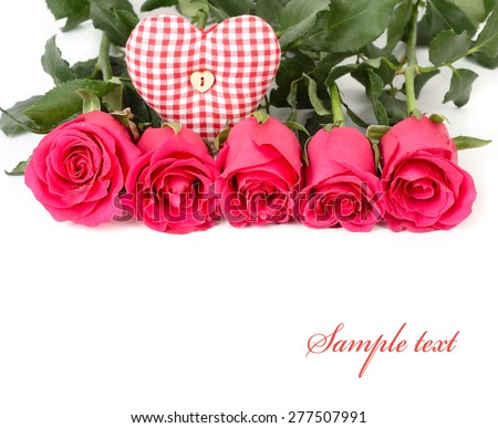 Pink roses and checkered heart on a white background.  - stock photo