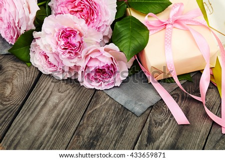 pink roses bouquet on a wall background - stock photo