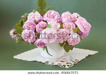 Pink roses bunch in vase on artistic background. Still life with pink roses bunch