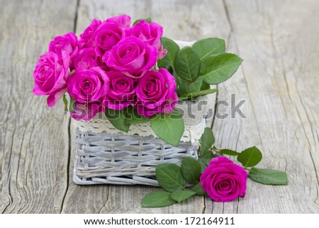 pink roses in a basket - stock photo