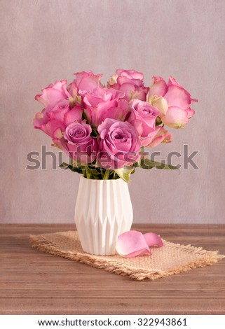 Pink roses in a vase - stock photo